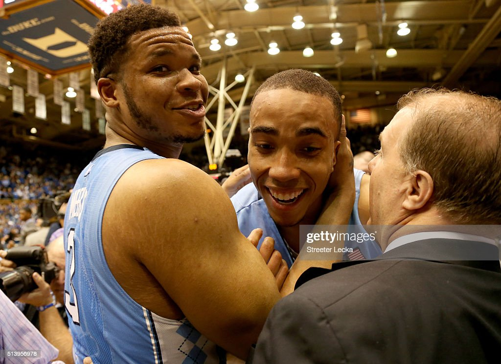 Teammates Kennedy Meeks and Brice Johnson of the North Carolina Tar Heels celebrate after defeating the Duke Blue Devils 7672 at Cameron Indoor...