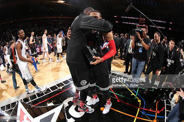 Teammates Kevin Durant and Russell Westbrook hug after playing for the Western Conference AllStar Team and after Russell Westbrook is awarded the Kia...