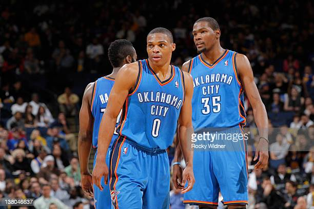 Teammates Kevin Durant Russell Westbrook and James Harden of the Oklahoma City Thunder briefly meet in a huddle during a game against the Golden...