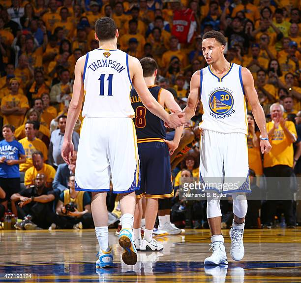 Teammates Klay Thompson of the Golden State Warriors and Stephen Curry of the Golden State Warriors highfive during Game Five of the 2015 NBA Finals...