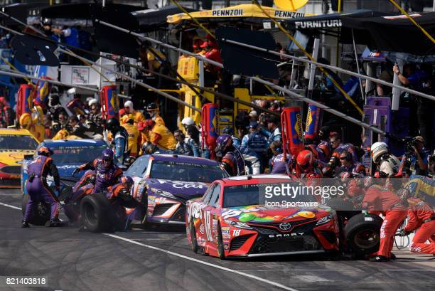 Teammates Kyle Busch Joe Gibbs Racing Toyota Camry and Denny Hamlin Joe Gibbs Racing Toyota Camry make pit stops early in the NASCAR Monster Energy...