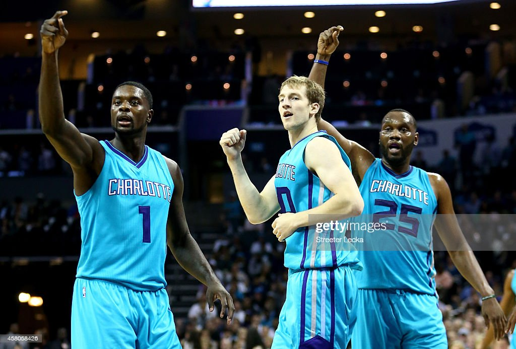 Teammates Lance Stephenson #1, Cody Zeller #40 and Al Jefferson #25 of the Charlotte Hornets react after a call against the Milwaukee Bucks during their game at Time Warner Cable Arena on October 29, 2014 in Charlotte, North Carolina.