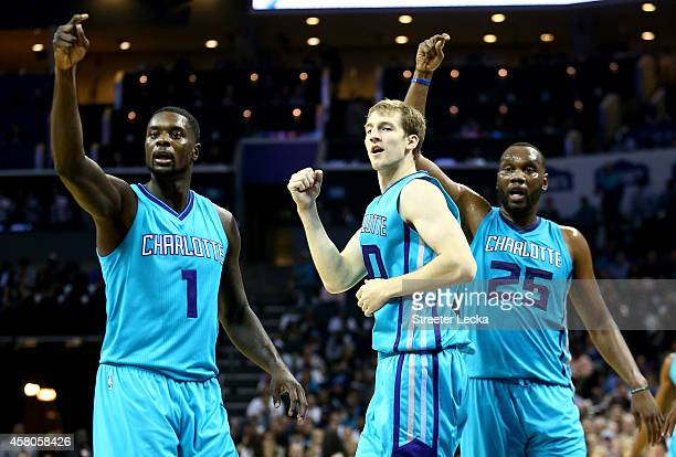 Teammates Lance Stephenson Cody Zeller and Al Jefferson of the Charlotte Hornets react after a call against the Milwaukee Bucks during their game at...