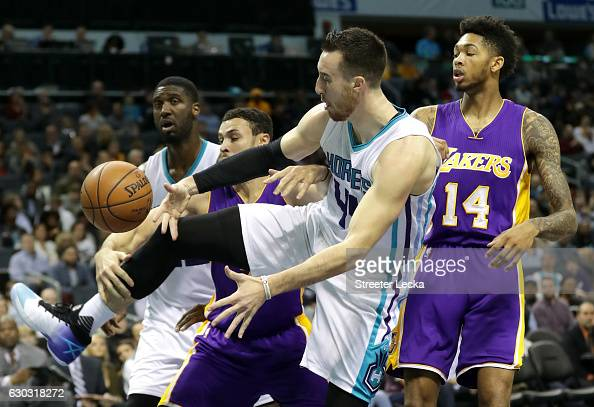 Teammates Larry Nance Jr #7 and Brandon Ingram of the Los Angeles Lakers go after a loose ball against teammates Roy Hibbert and Frank Kaminsky III...