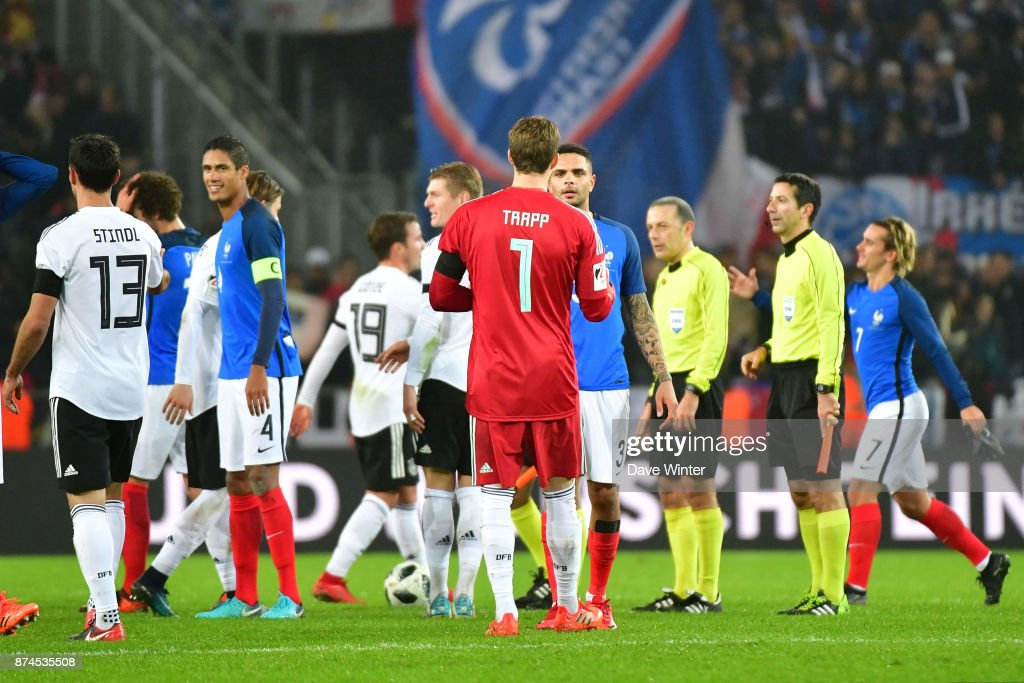 PSG teammates Layvin Kurzawa of France and Kevin Trapp of Germany at the end of the international friendly match between Germany and France at RheinEnergieStadion on November 14, 2017 in Cologne, Germany.