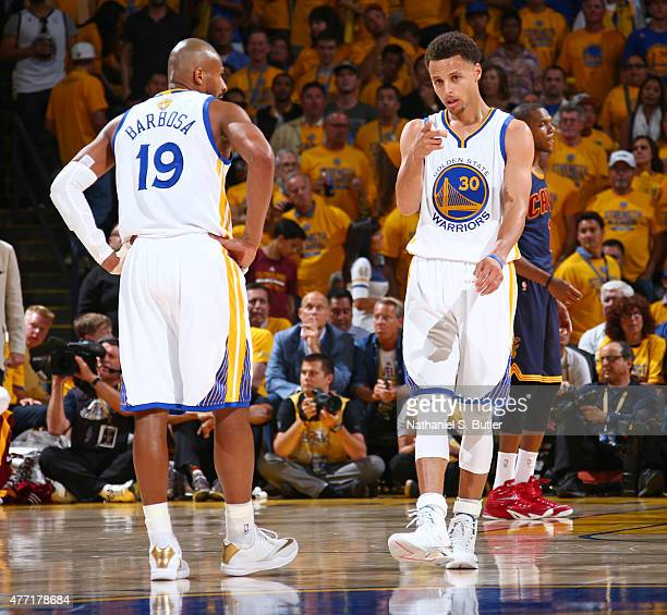 Teammates Leandro Barbosa of the Golden State Warriors and Stephen Curry of the Golden State Warriors react during Game Five of the 2015 NBA Finals...