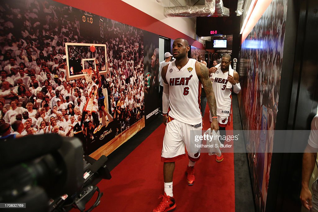 Teammates <a gi-track='captionPersonalityLinkClicked' href=/galleries/search?phrase=LeBron+James&family=editorial&specificpeople=201474 ng-click='$event.stopPropagation()'>LeBron James</a> #6 and <a gi-track='captionPersonalityLinkClicked' href=/galleries/search?phrase=Dwyane+Wade&family=editorial&specificpeople=201481 ng-click='$event.stopPropagation()'>Dwyane Wade</a> #3 of the Miami Heat after playing against the San Antonio Spurs in Game Six of the 2013 NBA Finals on June 18, 2013 at American Airlines Arena in Miami, Florida.