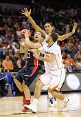 Teammates London Perrantes and Malcolm Brogdon of the Virginia Cavaliers try to stop Reece Chamberlain of the Belmont Bruins during the second round...