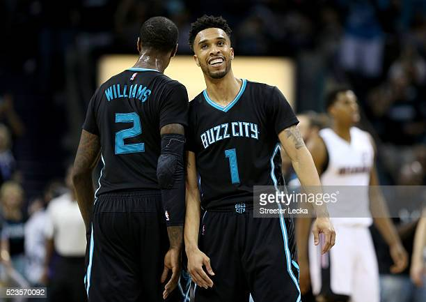 Teammates Marvin Williams and Courtney Lee of the Charlotte Hornets react after a play against the Miami Heat during game three of the Eastern...