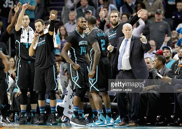 Teammates Michael KiddGilchrist and Marvin Williams of the Charlotte Hornets react at the bench as head coach Steve Clifford reacts during their game...