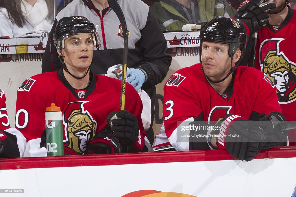Teammates Mike Lundin #10 and Marc Methot #3 of the Ottawa Senators xlook on from the bench during an NHL game against the Carolina Hurricanes at Scotiabank Place on February 7, 2013 in Ottawa, Ontario, Canada.