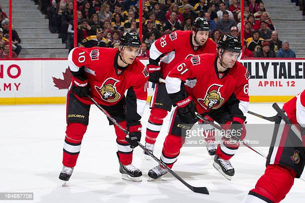 Teammates Mike Lundin Andre Benoit and Matt Kassian of the Ottawa Senators lineup for a faceoff during an NHL game against the Boston Bruins at...