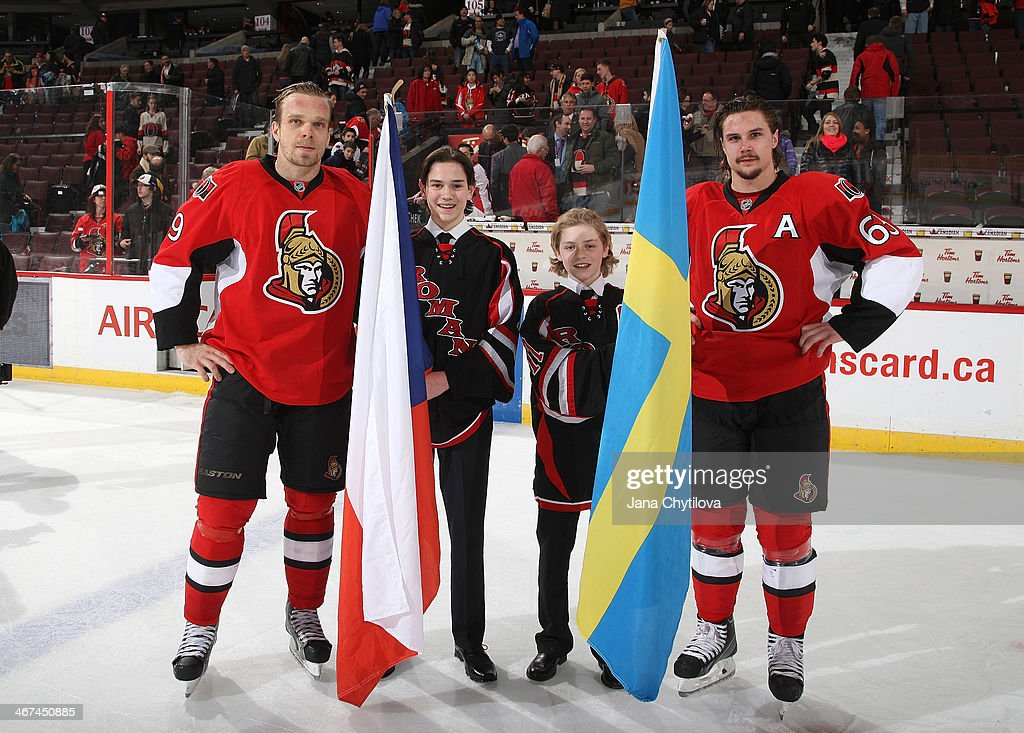 Teammates Milan Michalek #9 and Erik Karlsson #65 of the Ottawa Senators, who will be representing their native countries, stand at centre ice in a ceremony to honour the olympians following an NHL game against the Buffalo Sabres at Canadian Tire Centre on February 6, 2014 in Ottawa, Ontario, Canada.