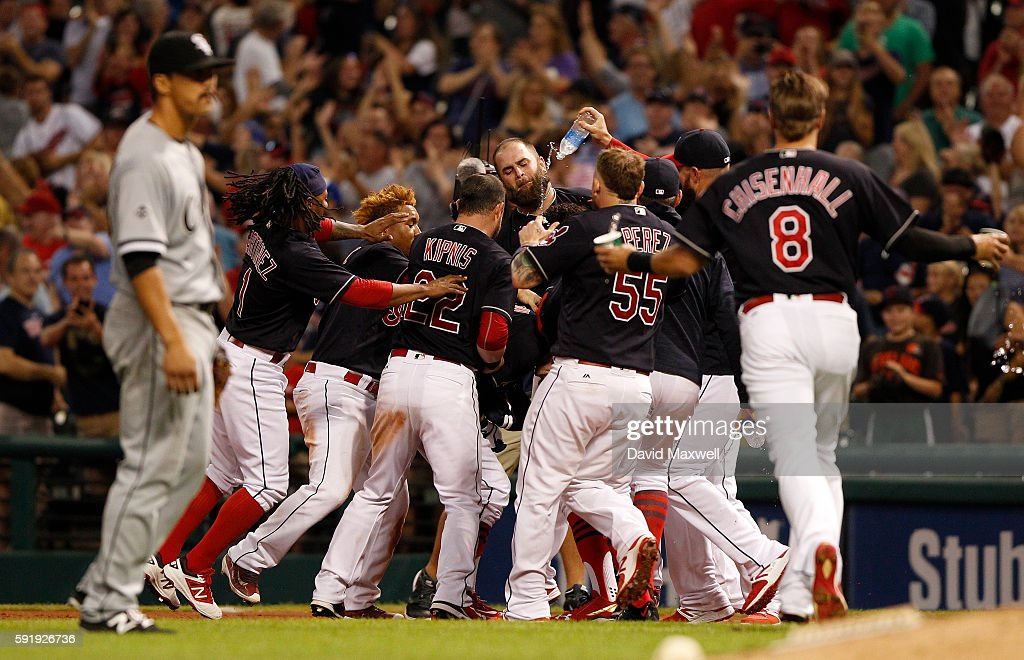 Teammates mob Tyler Naquin of the Cleveland Indians after he hit a game winning sacrifice fly against the Chicago White Sox in the ninth inning at...