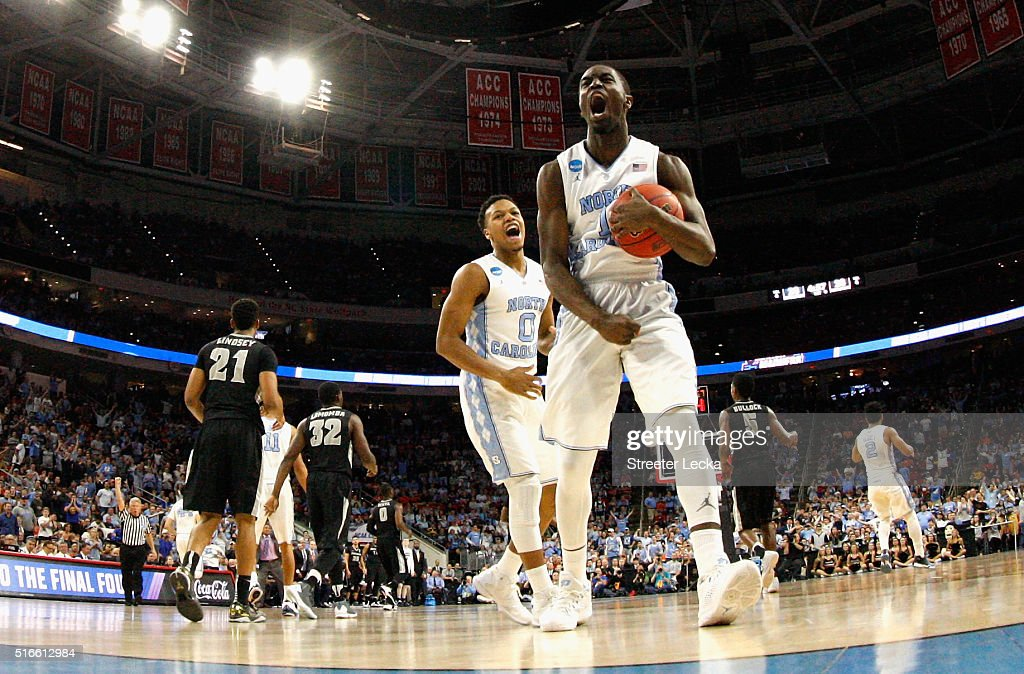 Teammates Nate Britt and Theo Pinson of the North Carolina Tar Heels react after a play against the Providence Friars during the second round of the...