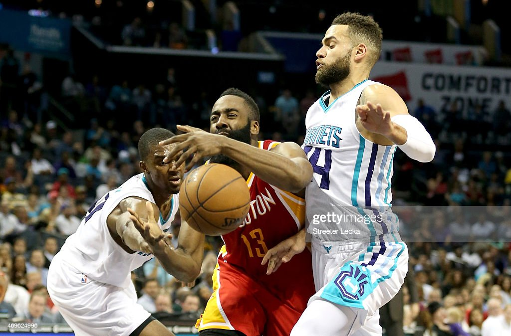 Teammates Noah Vonleh and Jeff Taylor of the Charlotte Hornets go after James Harden of the Houston Rockets during their game at Time Warner Cable...
