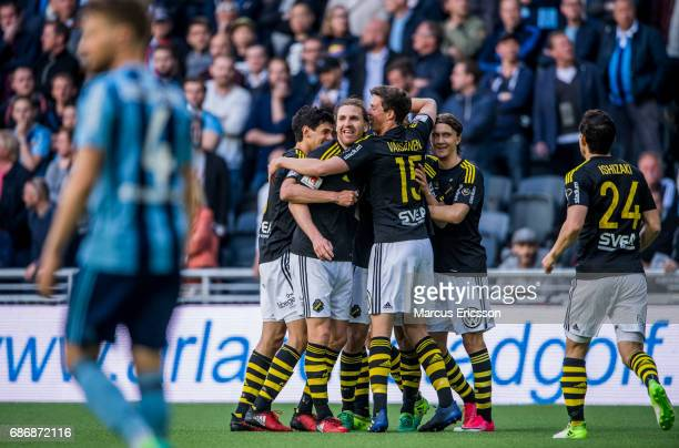 Teammates of AIK celebrates after the 10 goal by Simon Thern during the Allsvenskan match between Djurgardens IF and AIK at Tele2 Arena on May 22...