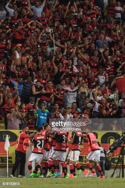 Teammates of Brazil's Flamengo celebrate Rodinei's first goal against Chile's Universidad Catolica during their Copa Libertadores 2017 football match...