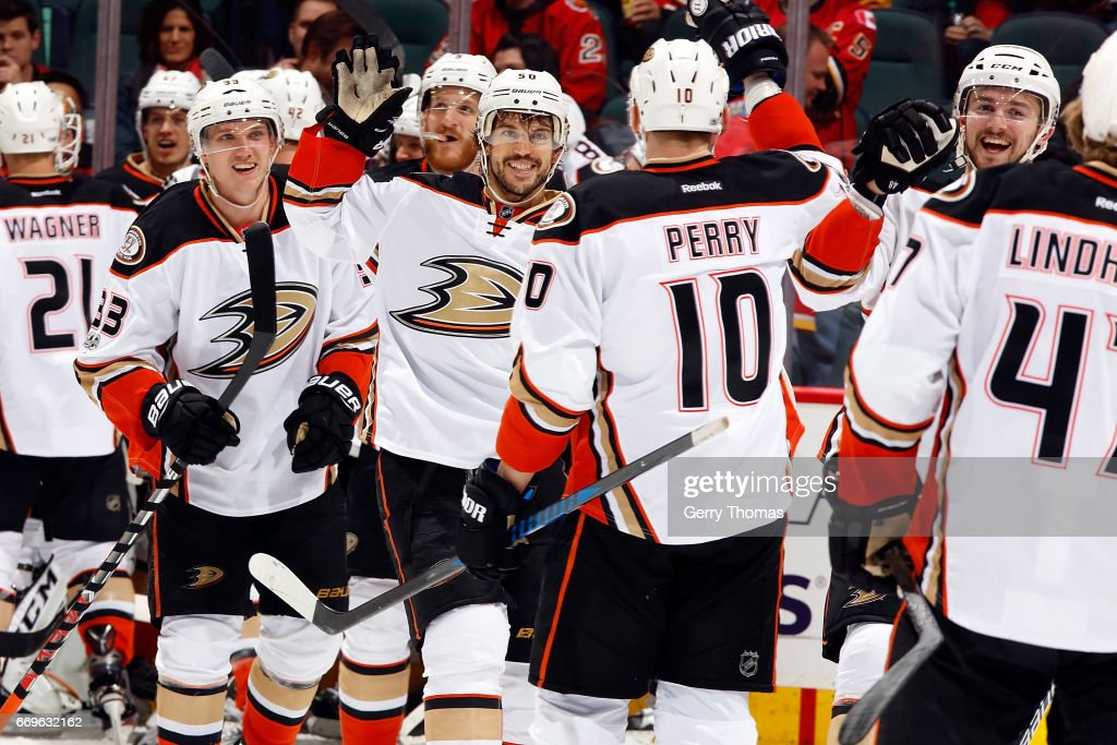 Teammates of the Anaheim Ducks celebrate an overtime win against the Calgary Flames after Game One of the Western Conference First Round during the 2017 NHL Stanley Cup Playoffs on April 17, 2017 at the Scotiabank Saddledome in Calgary, Alberta, Canada.