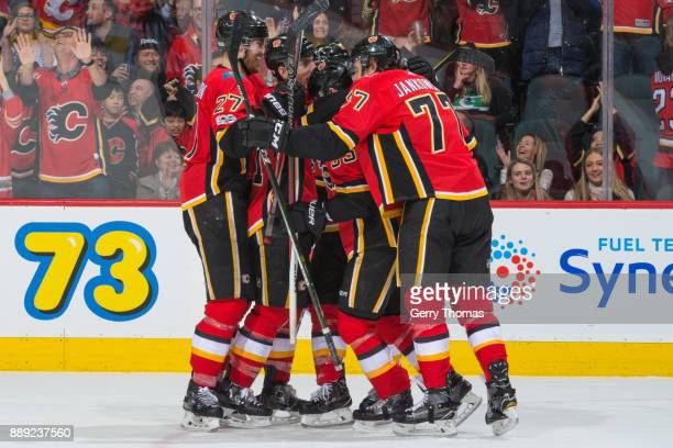 Teammates of the Calgary Flames celebrate in a NHL game against the Vancouver Canucks at the Scotiabank Saddledome on December 09 2017 in Calgary...