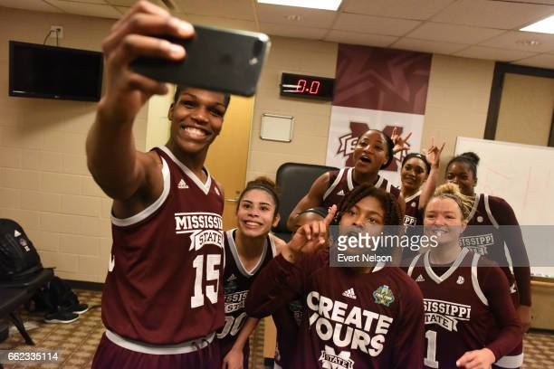 Teammates of the Mississippi State Lady Bulldogs take a selfie in the locker room following their victory of the University of Connecticut Huskies...