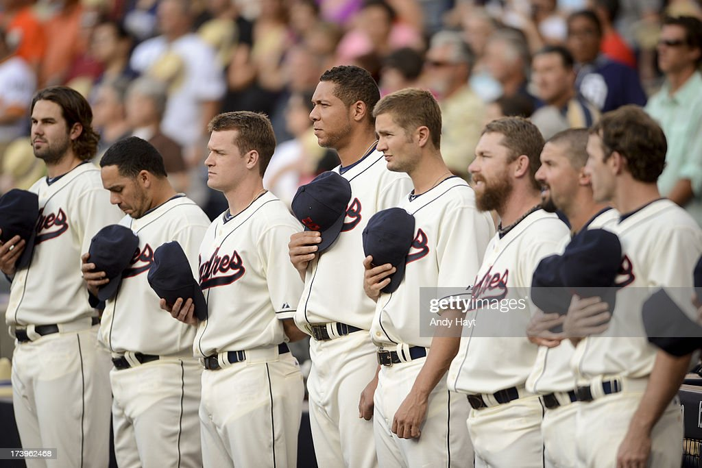 Teammates of the San Diego Padres stand at attention for the the National Anthem prior to the game against the San Francisco Giants at Petco Park on July 12, 2013 in San Diego California.