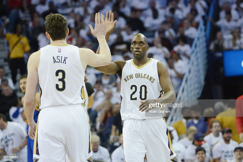 Teammates Omer Asik high fives Quincy Pondexter of the New Orleans Pelicans during Game Four of the Western Conference Quarterfinals against the...