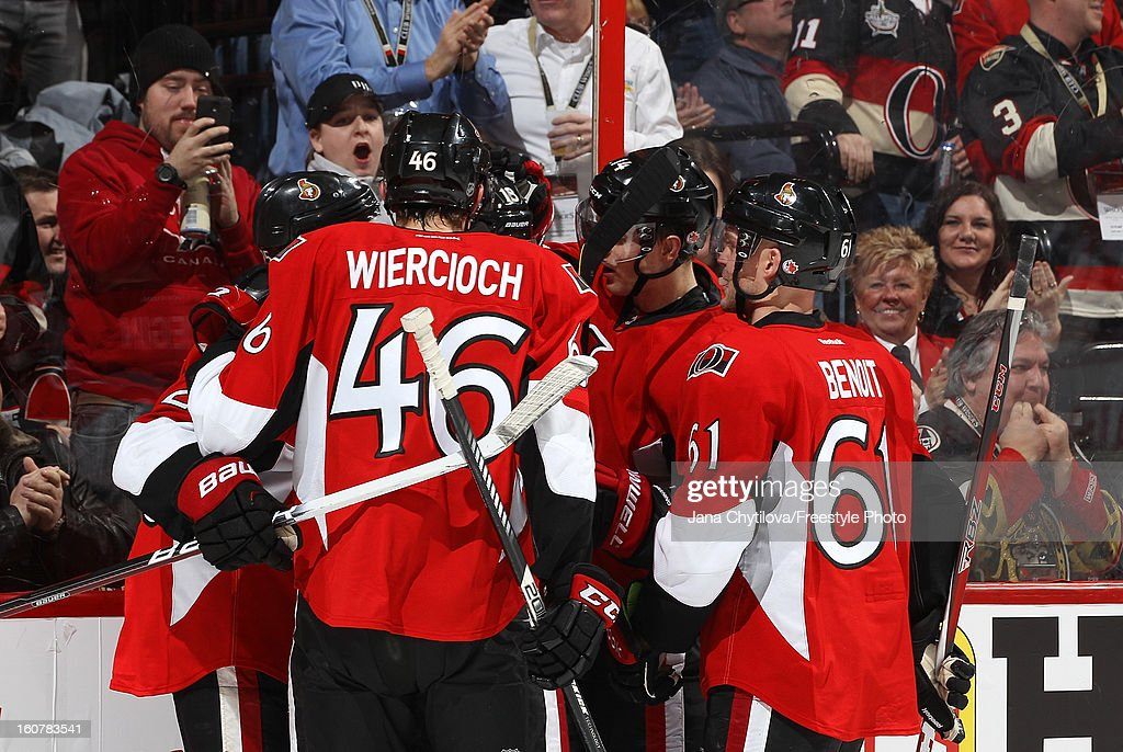 Teammates Patrick Wiercioch #46 and Andre Benoit #61 of the Ottawa Senators celebrate a second period goal against the Buffalo Sabres during an NHL game at Scotiabank Place on February 5, 2013 in Ottawa, Ontario, Canada.