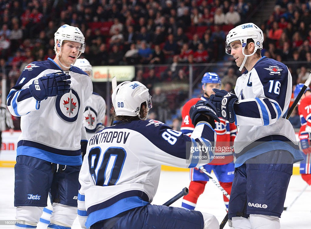 Teammates (L-R) Paul Postma #4, Nik Anropov #80 and <a gi-track='captionPersonalityLinkClicked' href=/galleries/search?phrase=Andrew+Ladd&family=editorial&specificpeople=228452 ng-click='$event.stopPropagation()'>Andrew Ladd</a> #16 of the Winnipeg Jets celebrate a second-period goal against the Montreal Canadiens in NHL action on January 29, 2013 at the Bell Centre in Montreal, Quebec, Canada.
