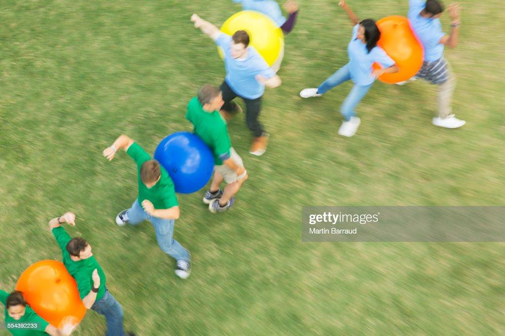 Teammates Performing Fitness Ball Team Building Activity ...