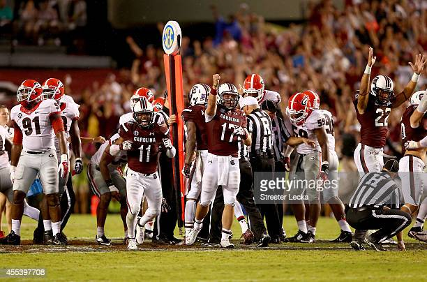 Teammates Pharoh Cooper and Dylan Thompson of the South Carolina Gamecocks react after making a first down late in the fourth quarter against the...