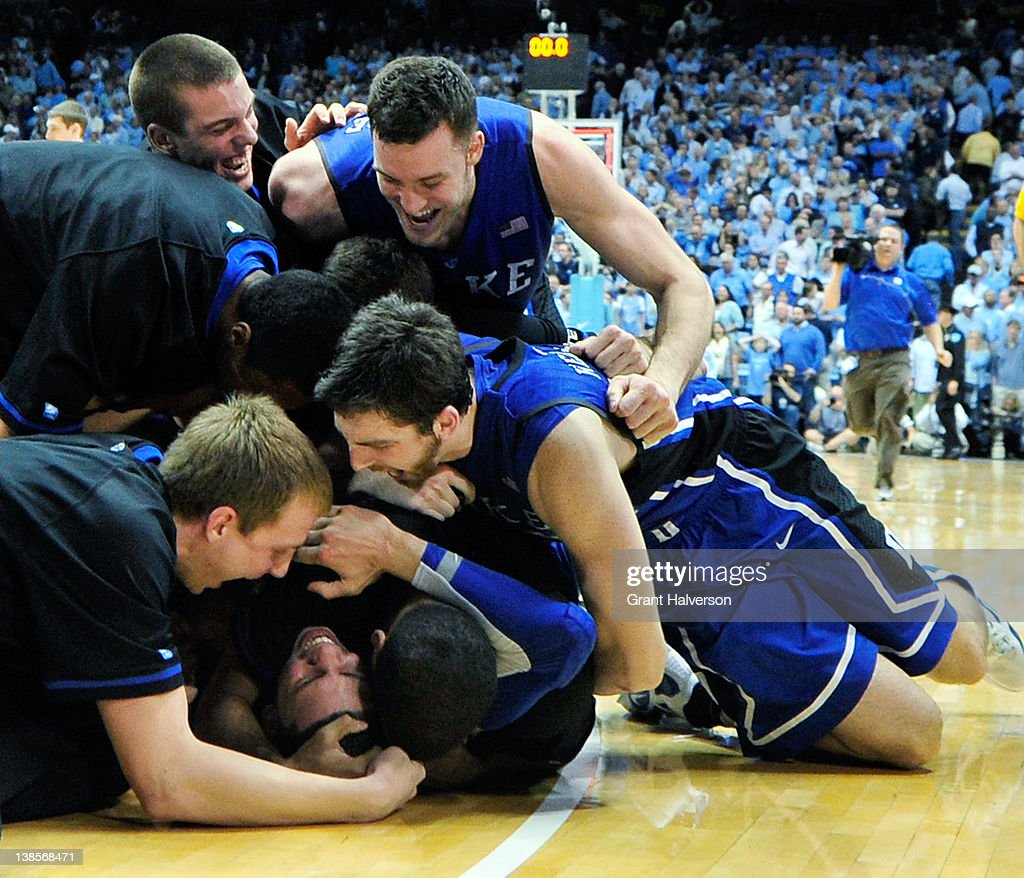 Teammates pile on Austin Rivers of the Duke Blue Devils after his gamewinning 3point basket against the North Carolina Tar Heels at the Dean Smith...