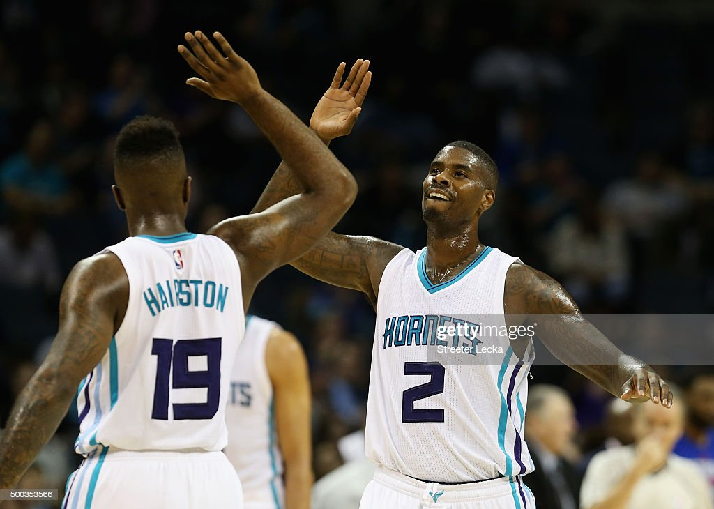 Teammates <a gi-track='captionPersonalityLinkClicked' href=/galleries/search?phrase=P.J.+Hairston&family=editorial&specificpeople=7621185 ng-click='$event.stopPropagation()'>P.J. Hairston</a> #19 and <a gi-track='captionPersonalityLinkClicked' href=/galleries/search?phrase=Marvin+Williams&family=editorial&specificpeople=206784 ng-click='$event.stopPropagation()'>Marvin Williams</a> #2 of the Charlotte Hornets react after a play during their game against the Detroit Pistons at Time Warner Cable Arena on December 7, 2015 in Charlotte, North Carolina. NBA -