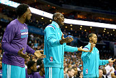 Teammates PJ Hairston Bismack Biyombo and Jannero Pargo of the Charlotte Hornets react to a call while on the bench during their game against the...