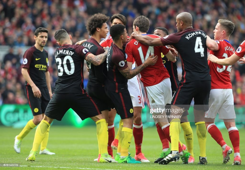 Teammates pull apart Manchester City's German midfielder Leroy Sane (3L) and Middlesbrough's Dutch midfielder Marten de Roon (4R) as they confront each other during the English Premier League football match between Middlesbrough and Manchester City at Riverside Stadium in Middlesbrough, northeast England on April 30, 2017. / AFP PHOTO / Lindsey PARNABY / RESTRICTED TO EDITORIAL USE. No use with unauthorized audio, video, data, fixture lists, club/league logos or 'live' services. Online in-match use limited to 75 images, no video emulation. No use in betting, games or single club/league/player publications. /