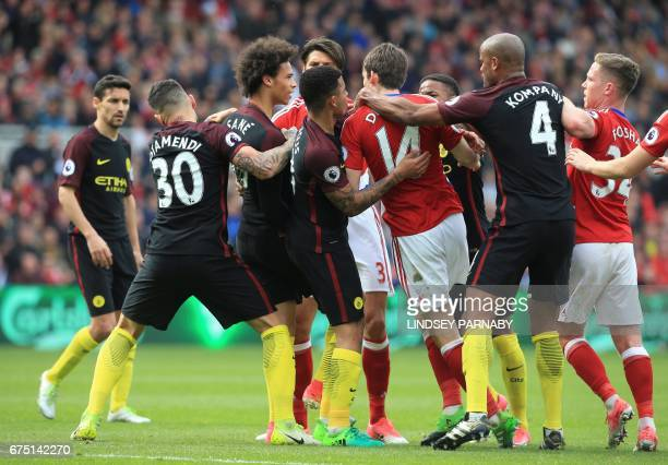 Teammates pull apart Manchester City's German midfielder Leroy Sane and Middlesbrough's Dutch midfielder Marten de Roon as they confront each other...