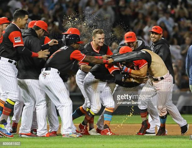 Teammates pull the jersey off of Yolmer Sanchez of the Chicago White Sox after he got the gamewining hit a run scoring single in the obttom of the...