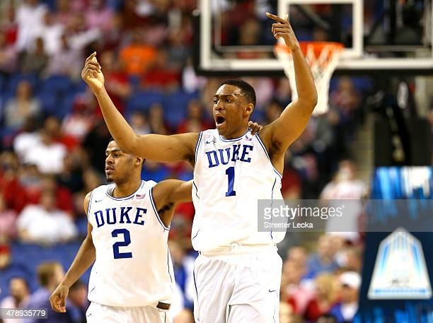 Teammates Quinn Cook and Jabari Parker of the Duke Blue Devils run down the court against the North Carolina State Wolfpack during the semifinals of...