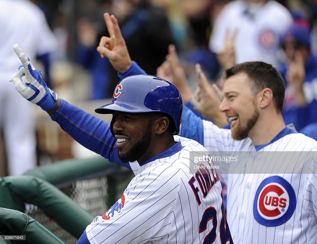 Teammates react after a home run by David Ross #3 of the Chicago Cubs against the Milwaukee Brewers during the second inning on April 28, 2016 at Wrigley Field in Chicago, Illinois.