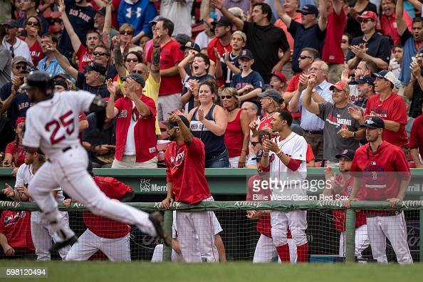 Teammates react as Jackie Bradley Jr #25 of the Boston Red Sox rounds first base after hitting an RBI double during the eighth inning of game against...
