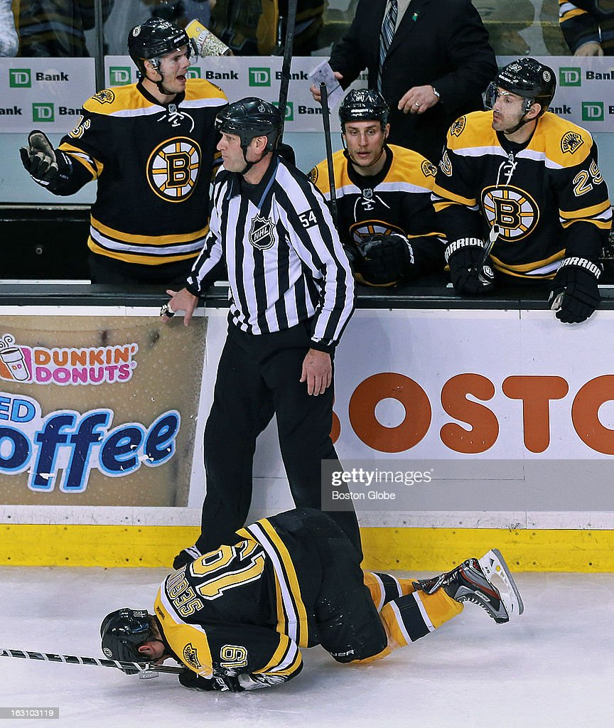 Teammates scream for a penalty call after the Bruins' Tyler Seguin falls to the ice after he was hit by the Canadiens' Alexei Emelin's stick in the second period. The incident sent Seguin to the locker room and precipitated teammate Zdeno Chara, not pictured, to retaliate. The Boston Bruins hosted the Montreal Canadiens in a regular season NHL hockey game at the TD Garden.