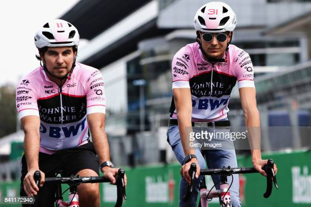 Teammates Sergio Perez of Mexico and Force India and Esteban Ocon of France and Force India cycle the track during previews for the Formula One Grand...