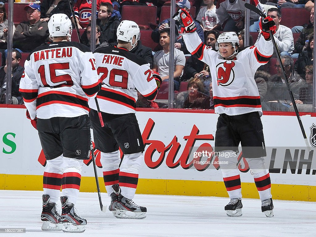 Teammates (L-R) Stefan Matteau #15, Mark Fayne #29 and Patrik Elias #26 of the New Jersey Devils celebrate thier second period goal against the Montreal Canadiens during the NHL game on January 27, 2013 at the Bell Centre in Montreal, Quebec, Canada.