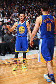 Teammates Stephen Curry and Klay Thompson of the Golden State Warriors during the Foot Locker Three Point Contest on State Farm AllStar Saturday...