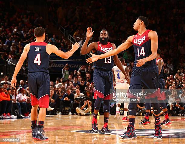 Teammates Stephen Curry James Harden and Anthony Davis of the USA Basketball Men's National Team highfive during a game against the Puerto Rico...