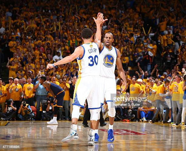 Teammates Stephen Curry of the Golden State Warriors and Andre Iguodala of the Golden State Warriors highfive during Game Five of the 2015 NBA Finals...