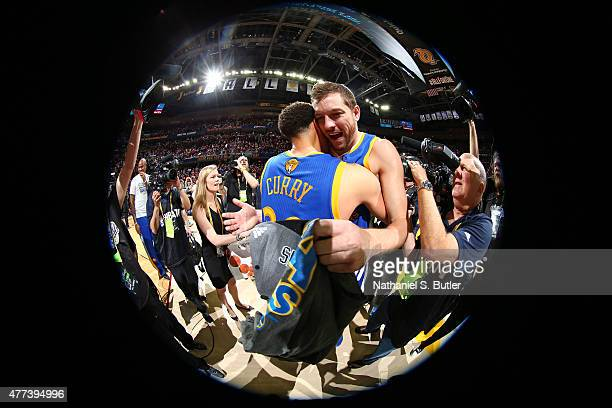 Teammates Stephen Curry of the Golden State Warriors and David Lee of the Golden State Warriors hugh after the Golden State Warriors win Game Six of...