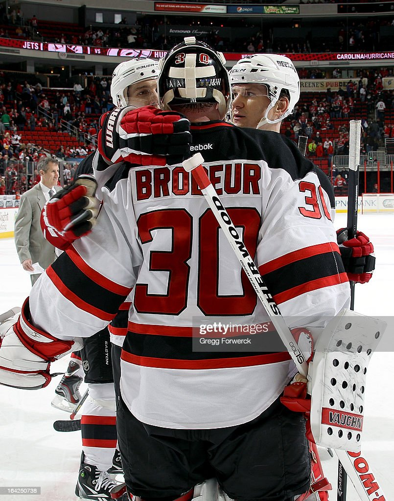 Teammates surround <a gi-track='captionPersonalityLinkClicked' href=/galleries/search?phrase=Martin+Brodeur&family=editorial&specificpeople=201594 ng-click='$event.stopPropagation()'>Martin Brodeur</a> #30 of the New Jersey Devils following the team's 4-1 victory over the Carolina Hurricanes at PNC Arena on March 21, 2013 in Raleigh, North Carolina. Brodeur recorded a goal in the first-period in his first start after returning from injury.