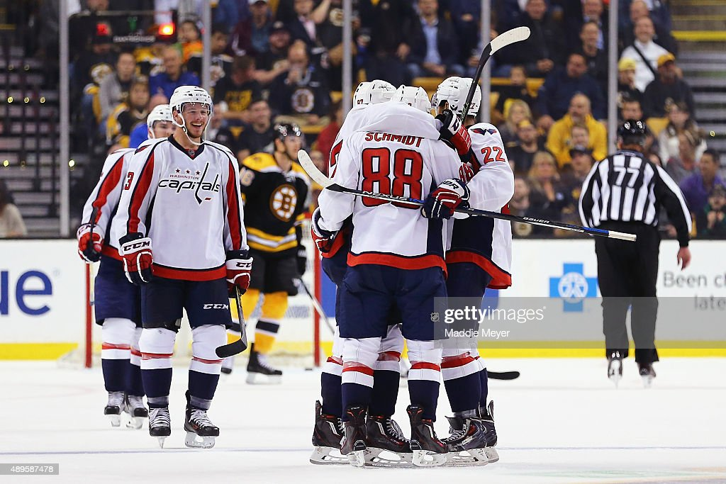 Teammates swarm Nate Schmidt #88 of the Washington Capitals after he scored against the Boston Bruins during the third period at TD Garden on September 22, 2015 in Boston, Massachusetts.