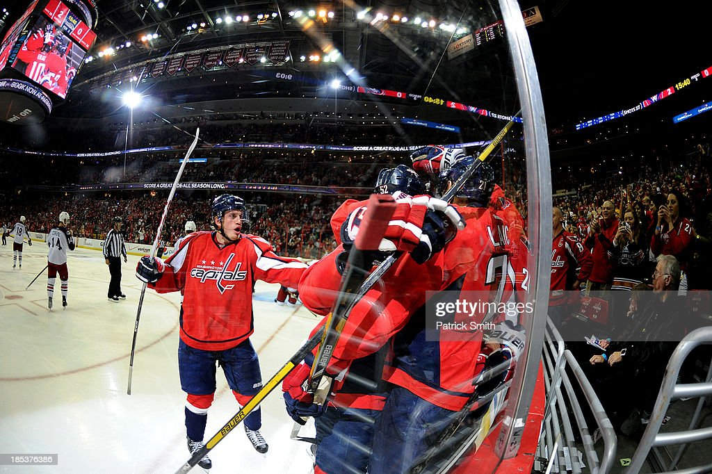 Teammates swarm <a gi-track='captionPersonalityLinkClicked' href=/galleries/search?phrase=Troy+Brouwer&family=editorial&specificpeople=4155305 ng-click='$event.stopPropagation()'>Troy Brouwer</a> #20 of the Washington Capitals after he scored a goal against the Columbus Blue Jackets in the third period at the Verizon Center on October 19, 2013 in Washington, DC.